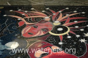 Detail of inlaid marble conference table top cut by waterjet