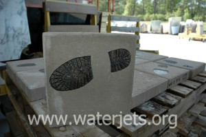 Bronze footprint inlaid into stone paver