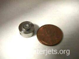 waterjet jewel next to a penny