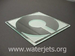 OMAX Logo etched in glass with an abrasivejet