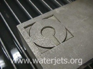 OMAX Logo showing milling with an abrasive jet.