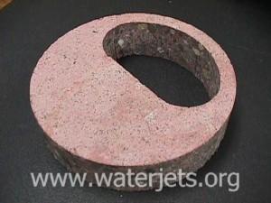 Concrete cut with an abrasive jet.