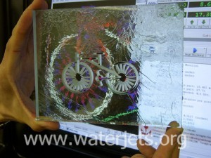Bicycle shape cut into glass by waterjet