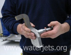 Steering spindle cut from steel by waterjet