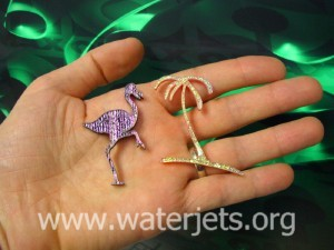 Glass flamingo and palm cut by waterjet