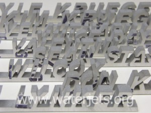 pictures of names cut with an abrasive waterjet