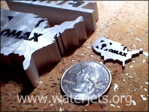 Waterjet parts cut with a minijet over a waterjet brick