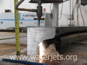 Thick titanium being cut by waterjet