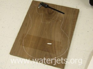 Chalk outline of wood prior to being cut by waterjet